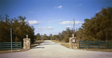 The main entrance to Prairie Creek West: Five-acre homesites and riding trails await within.